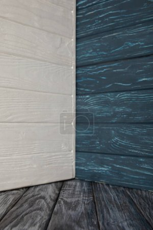 grey wooden floor and colored wooden walls
