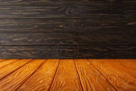 orange striped tabletop and dark wooden wall