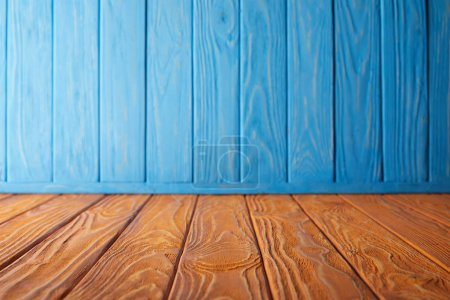 brown striped tabletop and blue wooden wall