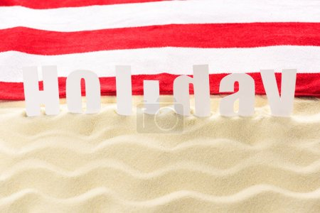 Photo for Holiday inscription in sandy beach waves - Royalty Free Image