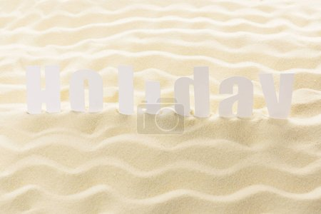 Word Holiday on sandy beach waves