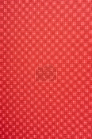 Photo for Small polka dot pattern on red background - Royalty Free Image