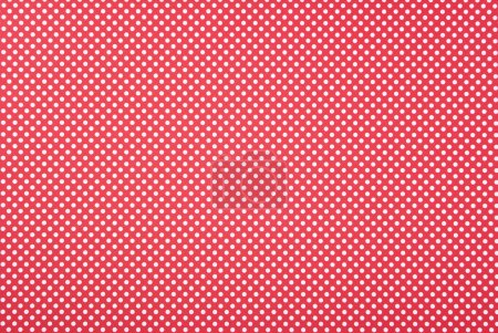 Texture of polka dot pattern on red background