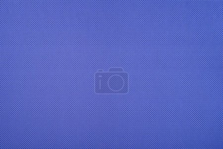 Texture of polka dot pattern on blue background