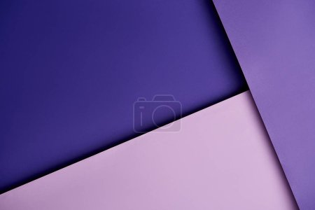 Abstract background with paper sheets in purple tones