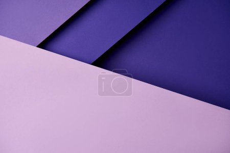 Paper sheets in purple tones background