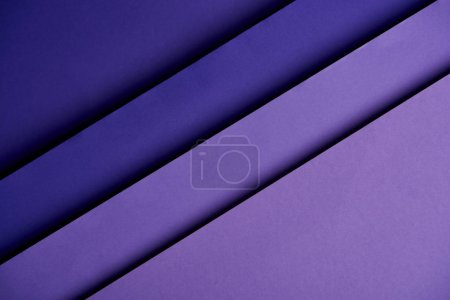 Pattern of overlapping paper sheets in purple tones