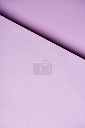 Paper sheets in light purple tones background