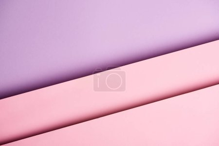 Pattern of overlapping paper sheets in purple and pink tones