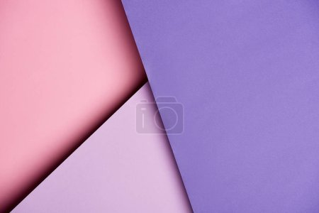 Abstract background with purple and pink overlapping paper sheets