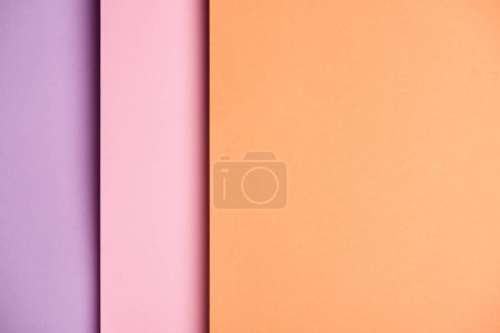 Paper sheets in pink and orange tones background