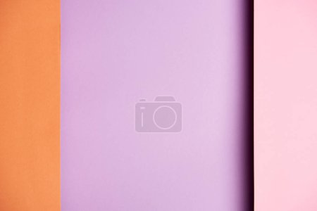 Pattern of overlapping paper sheets in purple and orange
