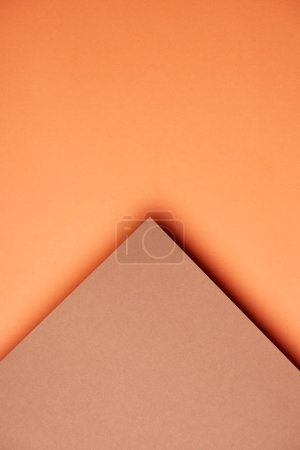 Abstract background with paper sheets in orange and brown corner