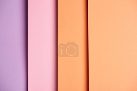 Vertical background with paper sheets in pink and orange