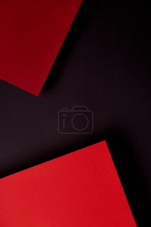 Paper sheets in red and black tones background