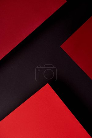 Abstract background with red paper sheets on black