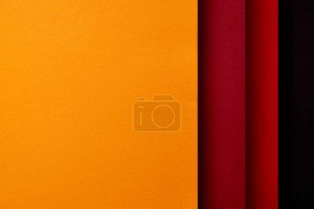 Photo for Paper sheets in red and yellow tones background - Royalty Free Image