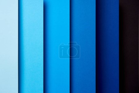Pattern of overlapping paper sheets in blue tones