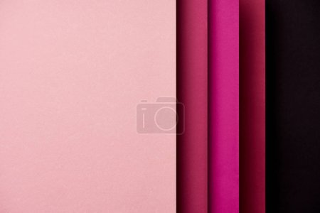 Pattern of overlapping paper sheets in pink tones