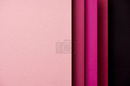 Patrón de hojas de papel superpuestas en tonos rosados