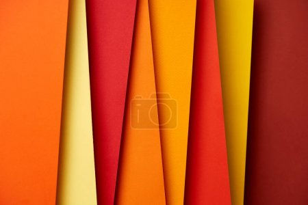 Paper sheets in warm colors background