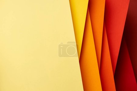 Pattern of overlapping paper sheets in red and yellow tones
