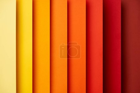 Photo for Abstract background with vertical paper sheets in red and yellow tones - Royalty Free Image