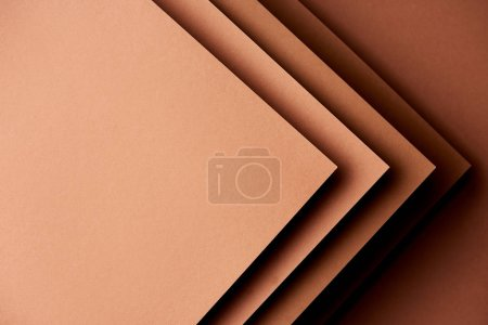 Paper sheets in brown tones background
