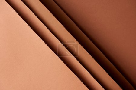 Pattern of overlapping paper sheets in brown tones