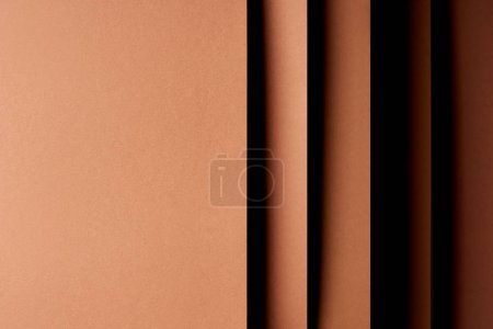 Abstract background with paper sheets in brown tones