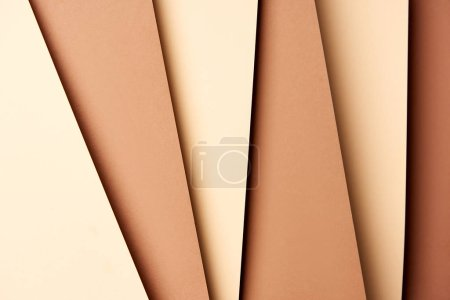 Pattern of overlapping paper sheets in beige and brown tones