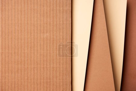 Paper sheets in beige and brown tones background