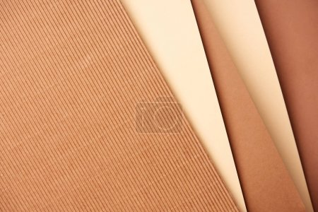 Photo for Pattern of diagonal paper sheets in beige and brown tones - Royalty Free Image