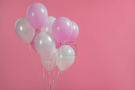 Surprise party decoration with balloons isolated on pink