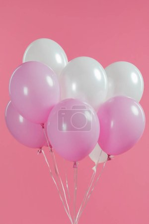 Decorative white and pink balloons isolated on pink