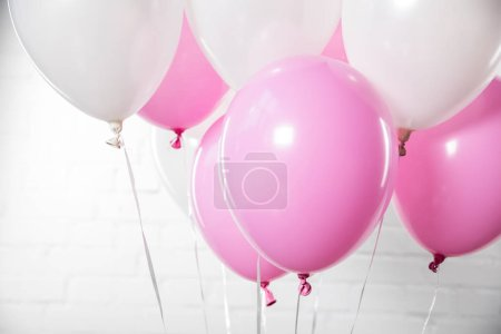 Photo for Decorative white and pink balloons on white brick wall background - Royalty Free Image