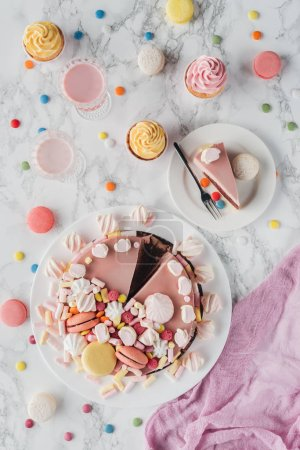 Photo for Flat lay with birthday cake, marshmallows, candies, sweet cupcakes and milkshakes - Royalty Free Image