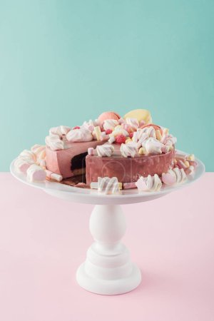Photo for Sweet cake with marshmallows and macarons on cake stand - Royalty Free Image