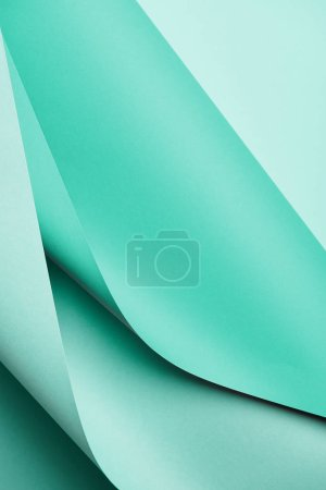 close-up view of bright turquoise colored paper textured background