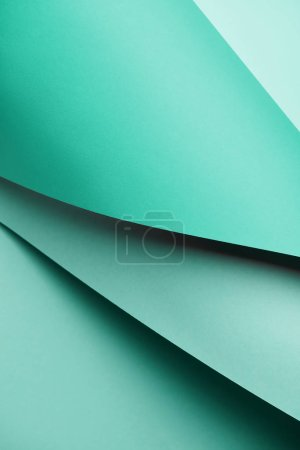 close-up view of abstract creative bright turquoise textured paper background