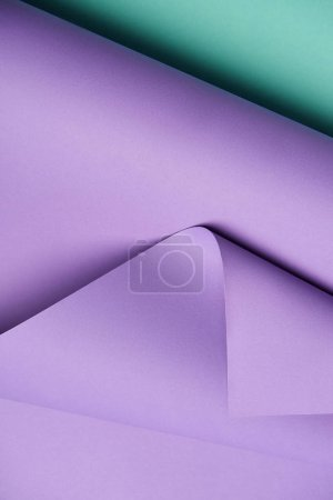 close-up view of beautiful violet and turquoise abstract paper background