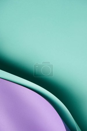 close-up view of beautiful turquoise and violet paper background