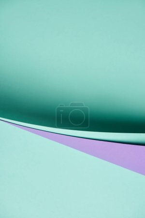 close-up view of beautiful purple and turquoise abstract paper background