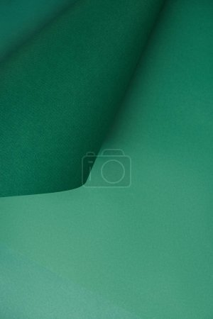 close-up view of green abstract colored paper textured background