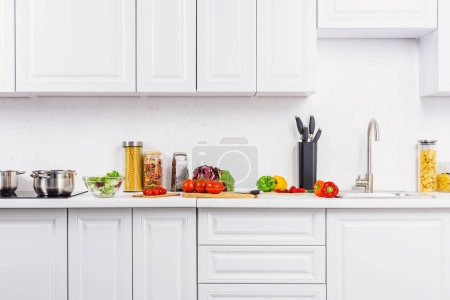 Photo for Ripe vegetables on kitchen counter in light kitchen - Royalty Free Image
