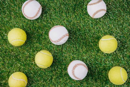 Photo for Flat lay with arrangement of tennis and baseball balls on green grass - Royalty Free Image