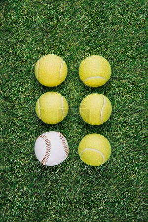 flat lay with arrangement of tennis and baseball balls on green grass