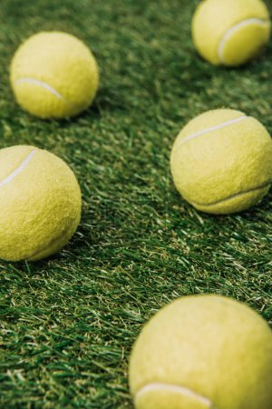 Photo for Close up view of tennis balls on green lawn - Royalty Free Image