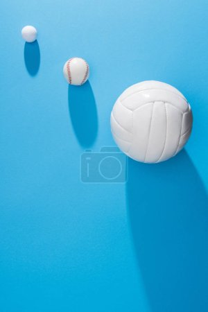 top view of arranged various balls on blue background