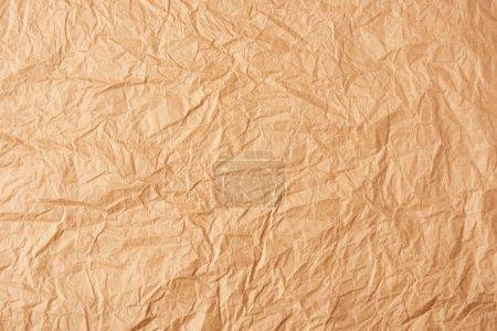 Photo pour Plein cadre de papier froissé beige comme toile de fond - image libre de droit